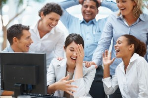 Business colleagues enjoying a laugh on a funny email